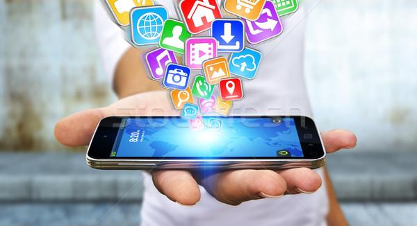 Zakenman moderne mobiele telefoon hand toepassingen vliegen Stockfoto © sdecoret