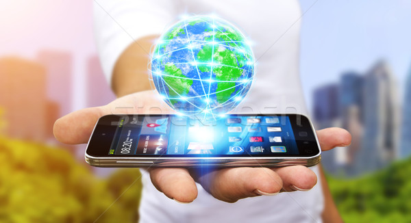 Businessman surfing on internet with modern mobile phone Stock photo © sdecoret