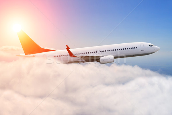 Planeflying over the clouds Stock photo © sdecoret