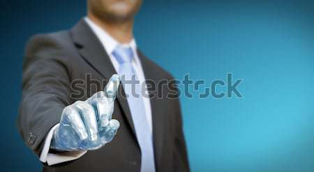 Businessman robot hand Stock photo © sdecoret