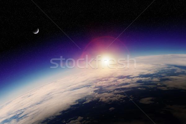 Sunrise planète terre espace vue ciel coucher du soleil Photo stock © sdecoret
