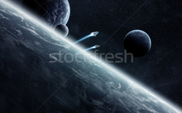 Sunrise over planets in space Stock photo © sdecoret