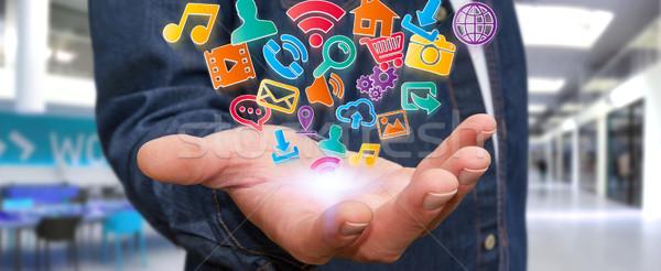 Businessman using modern digital icon application Stock photo © sdecoret