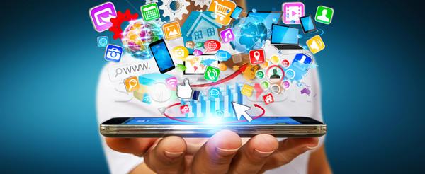 бизнесмен современных мобильного телефона применения стороны иконки Сток-фото © sdecoret