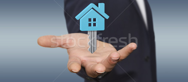 Empresário imóveis digital chave voador Foto stock © sdecoret