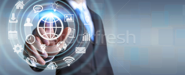Businessman using digital tactile screen interface with web icon Stock photo © sdecoret