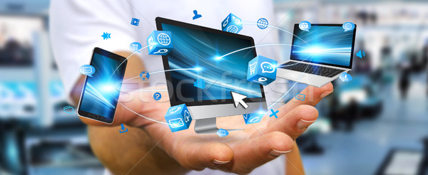 Businessman connecting tech device in his hand Stock photo © sdecoret