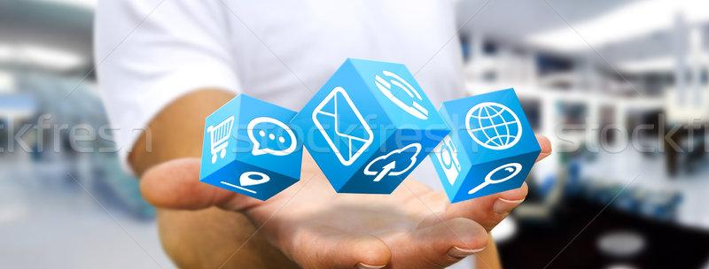 Businessman using modern cube interface Stock photo © sdecoret