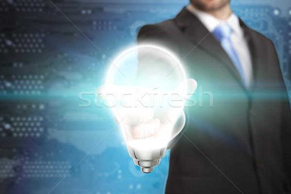 Empresário idéia homem de negócios lâmpada mão Foto stock © sdecoret