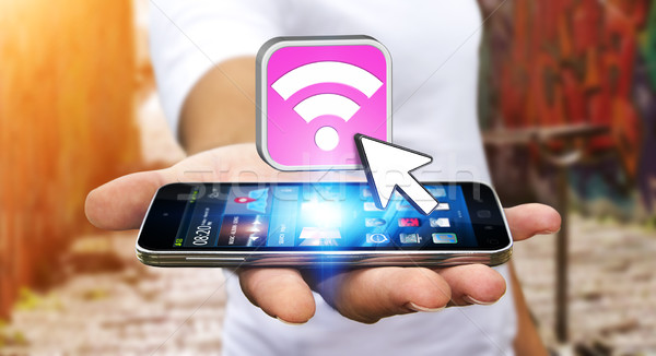 Joven moderna móviles contactar wifi teléfono móvil Foto stock © sdecoret