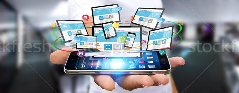 Businessman connecting tech devices Stock photo © sdecoret