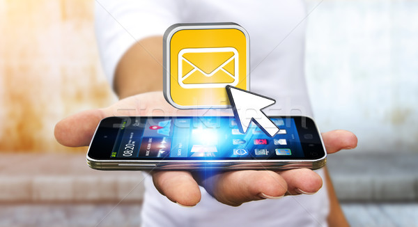 Young man using modern mobile phone to send message Stock photo © sdecoret