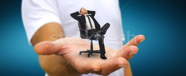 Man relaxing on his chair at the office Stock photo © sdecoret