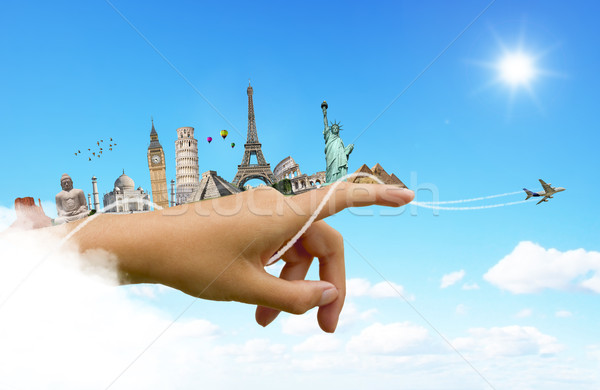 Monuments of the world on a woman hand Stock photo © sdecoret