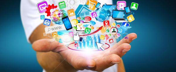 üzletember modern applikációk ikonok repülés kéz Stock fotó © sdecoret
