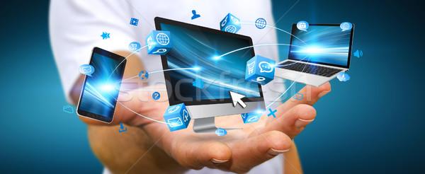 üzletember kapcsolódik tech berendezés kéz eszközök Stock fotó © sdecoret