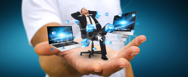 Man on his chair at the office connected to modern devices Stock photo © sdecoret