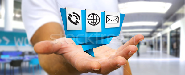 Businessman using modern digital origami icon application Stock photo © sdecoret