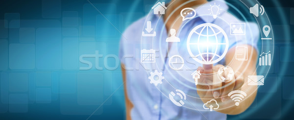 Businesswoman using digital tactile screen interface with web ic Stock photo © sdecoret
