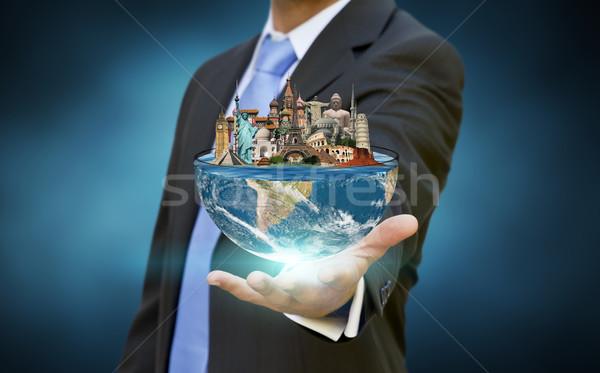 Foto stock: Empresário · escolher · férias · metade · planeta · terra · mãos