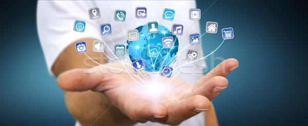 üzletember modern digitális applikációk fiatalember tart Stock fotó © sdecoret