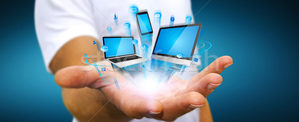 Businessman holding tech device in his hand Stock photo © sdecoret