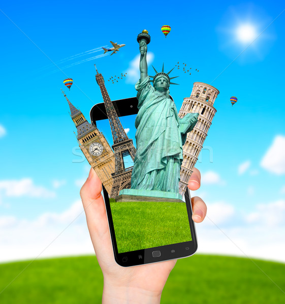 Famous monuments of the world going out of a mobile phone Stock photo © sdecoret