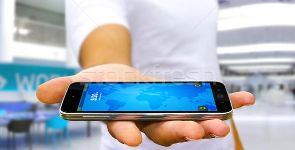 молодым человеком современных мобильного телефона бизнесмен стороны служба Сток-фото © sdecoret