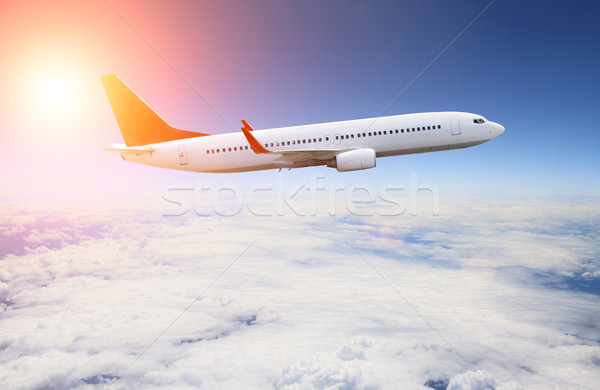 Plane flying over the clouds Stock photo © sdecoret