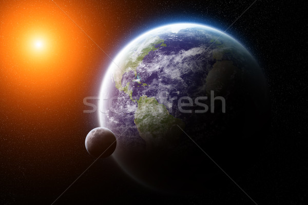 Nascer do sol planeta terra espaço ver sol pôr do sol Foto stock © sdecoret