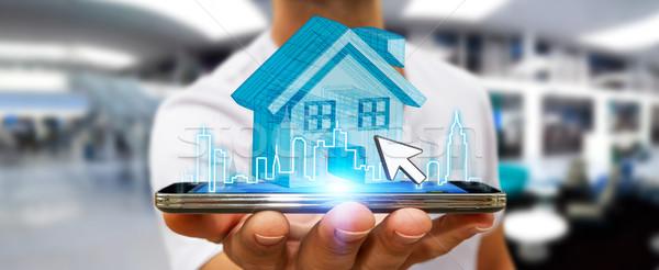 Empresário imóveis telefone móvel digital casa cidade Foto stock © sdecoret