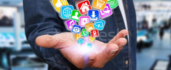 бизнесмен современных применения иконки Flying стороны Сток-фото © sdecoret