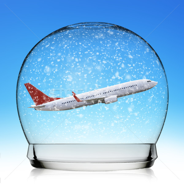 Planeflying in a snowball Stock photo © sdecoret