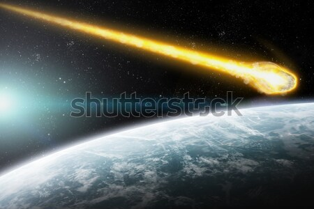Asteroids over planet earth Stock photo © sdecoret