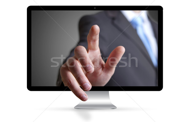 Businessman escaping from computer Stock photo © sdecoret