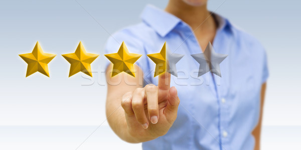 Sternen jungen Geschäftsfrau Ranking digitalen Stock foto © sdecoret