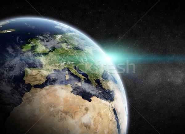 Sunrise planète espace vue soleil coucher du soleil Photo stock © sdecoret
