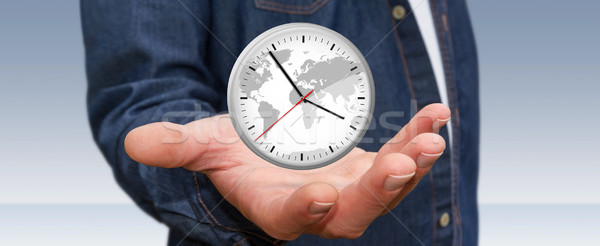Businessman holding a clock in his hand Stock photo © sdecoret