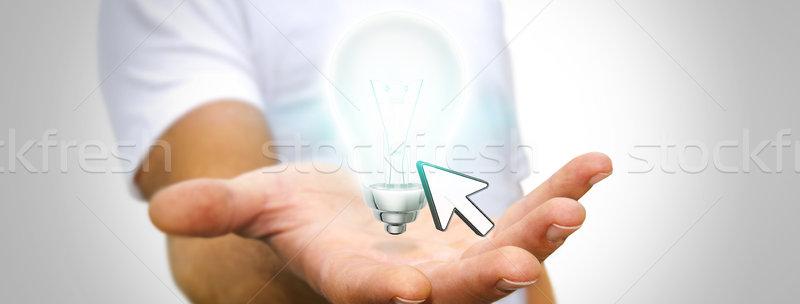 Imprenditore lampadina giovane mano ufficio Foto d'archivio © sdecoret