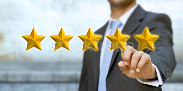 Young man rating stars Stock photo © sdecoret