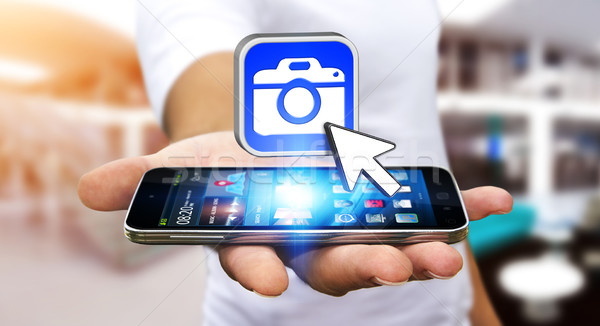 Stock photo: Young man using modern camera application