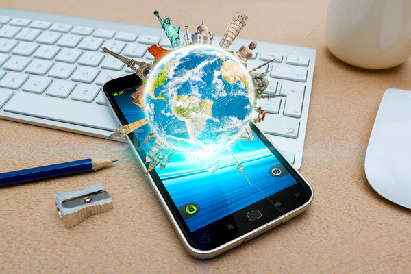 Modern mobile phone with digital world landmarks Stock photo © sdecoret