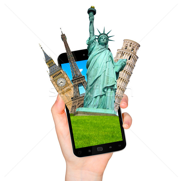 Famous monuments of the world going out of a mobile phone on whi Stock photo © sdecoret