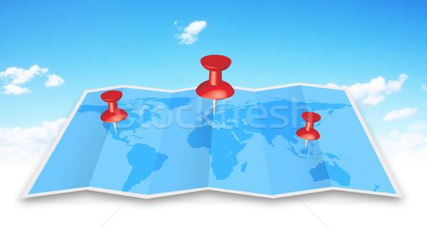 Pin map iconon a blue map Stock photo © sdecoret