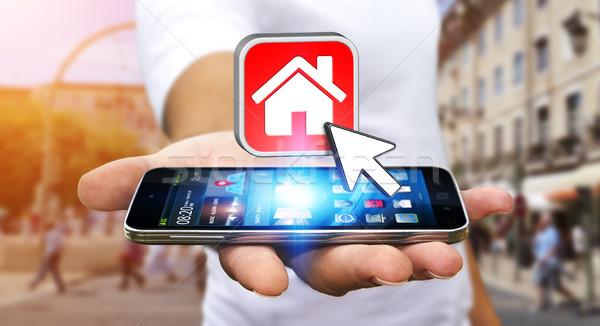 бизнесмен современных мобильного телефона аренда стороны путешествия Сток-фото © sdecoret