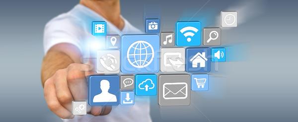 Empresário moderno digital ícone aplicação jovem Foto stock © sdecoret