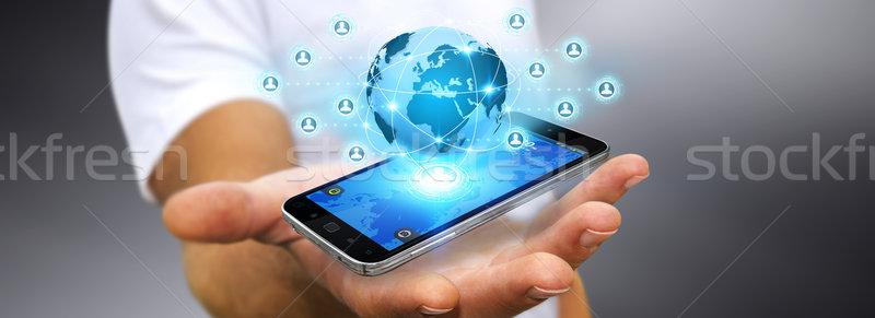 бизнесмен современных мобильного телефона стороны применение Сток-фото © sdecoret