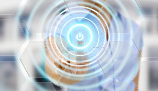 Businesswoman power button Stock photo © sdecoret