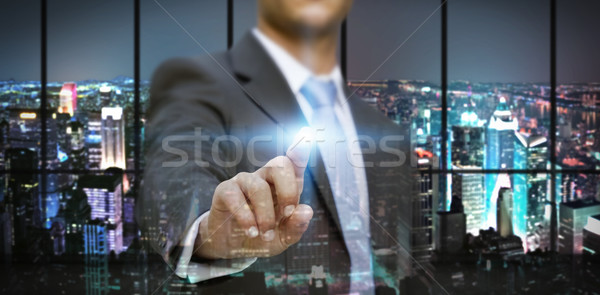 Businessman in his office using tactile interface Stock photo © sdecoret