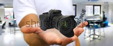 Fiatalember modern kamera tart digitális fényképezőgép kéz Stock fotó © sdecoret